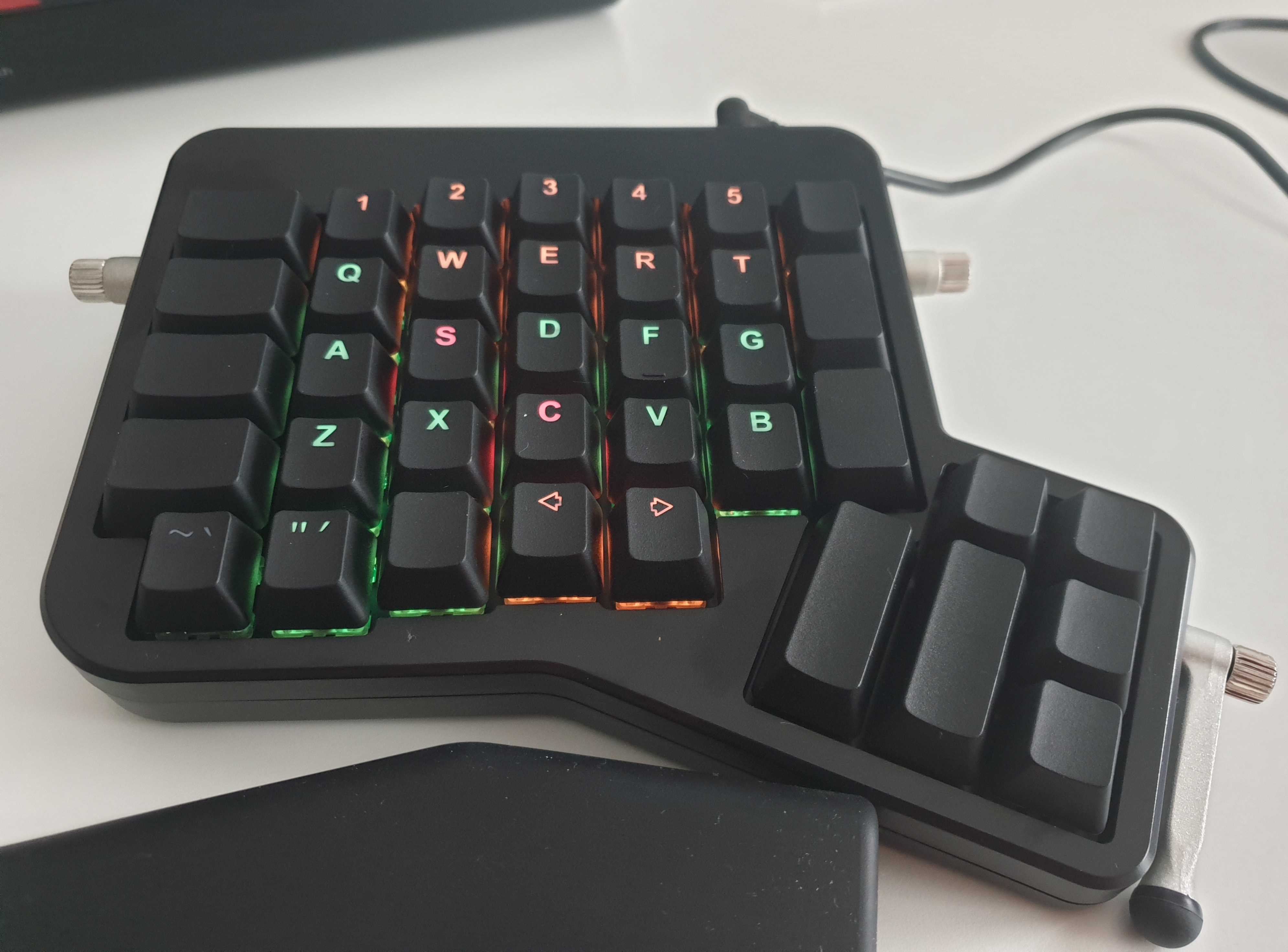 red and orange are special keys, also notice how so thumb keys are too far to use regularly